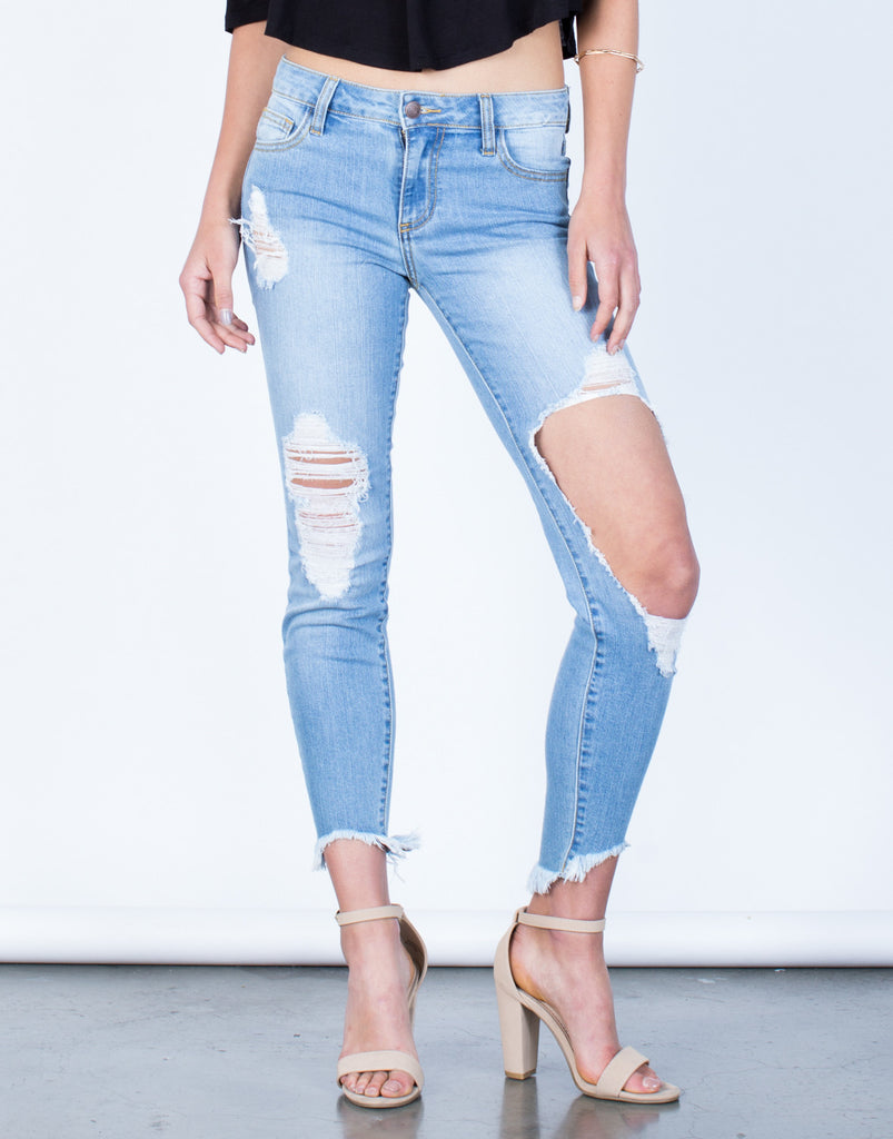Front View of Ripped Knee Step Hem Jeans