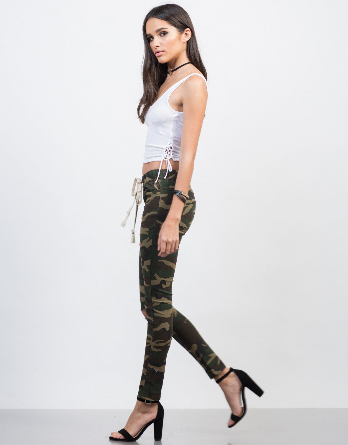 Side View of Ripped Knees Camo Pants