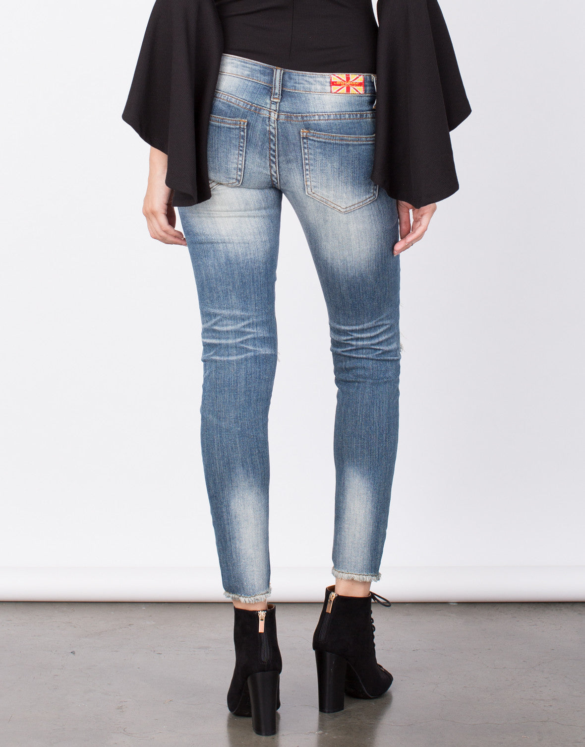 Back View of Ripped Knees Frayed Jeans