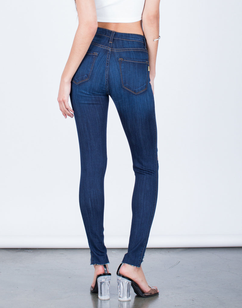 Back View of Ripped Step Hem Jeans