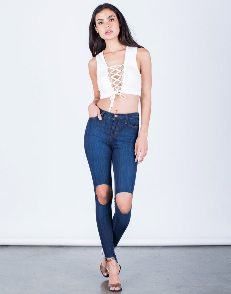 Front View of Ripped Step Hem Jeans