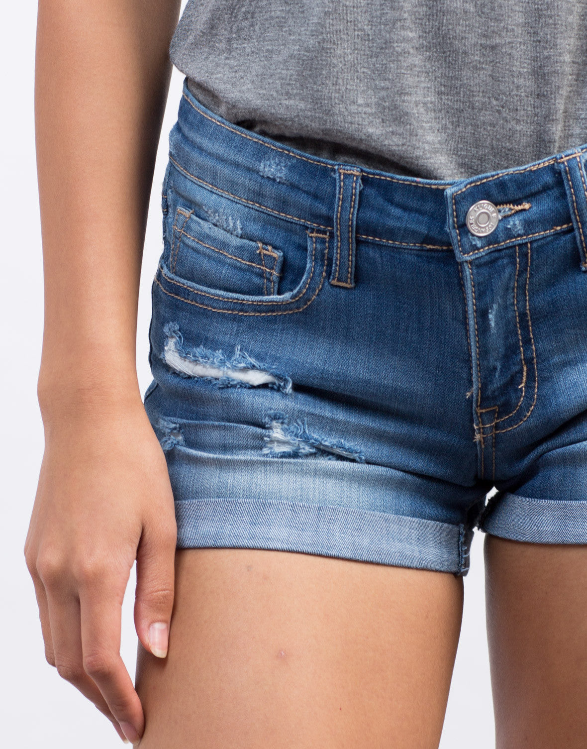 Detail of Rolled Up Denim Shorts