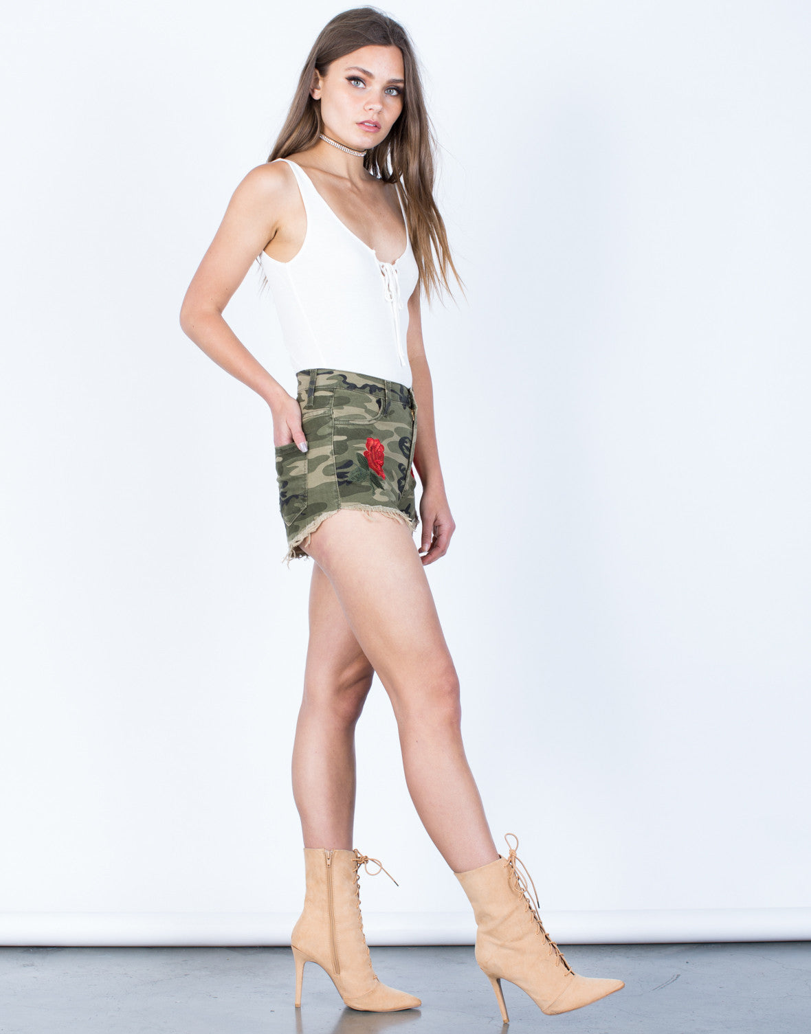Side View of Rose Embroidered Camo Shorts