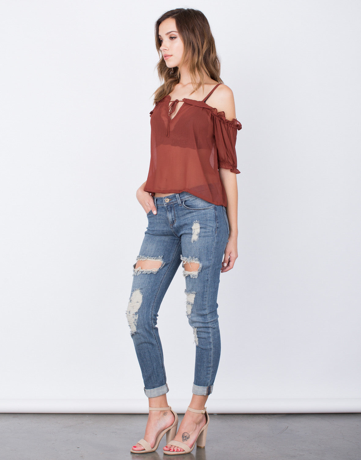 Side View of Ruffled Cold Shoulder Top