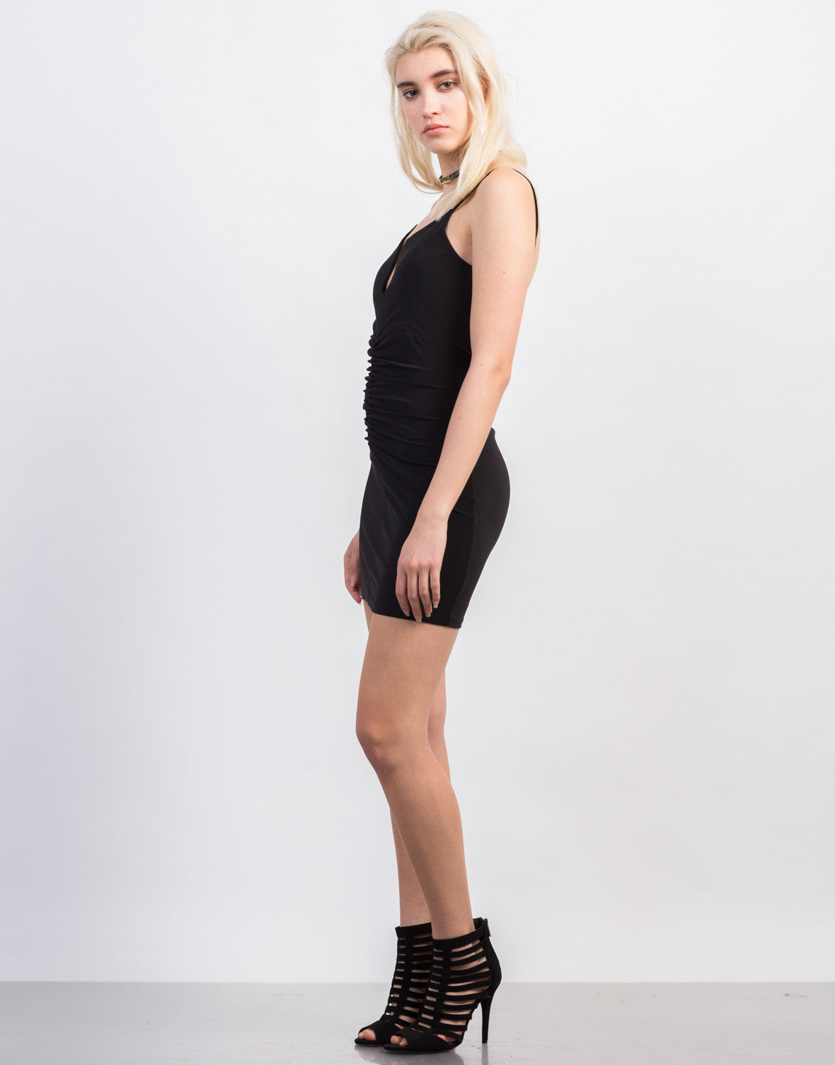 Side View of Scrunched Mini Black Dress