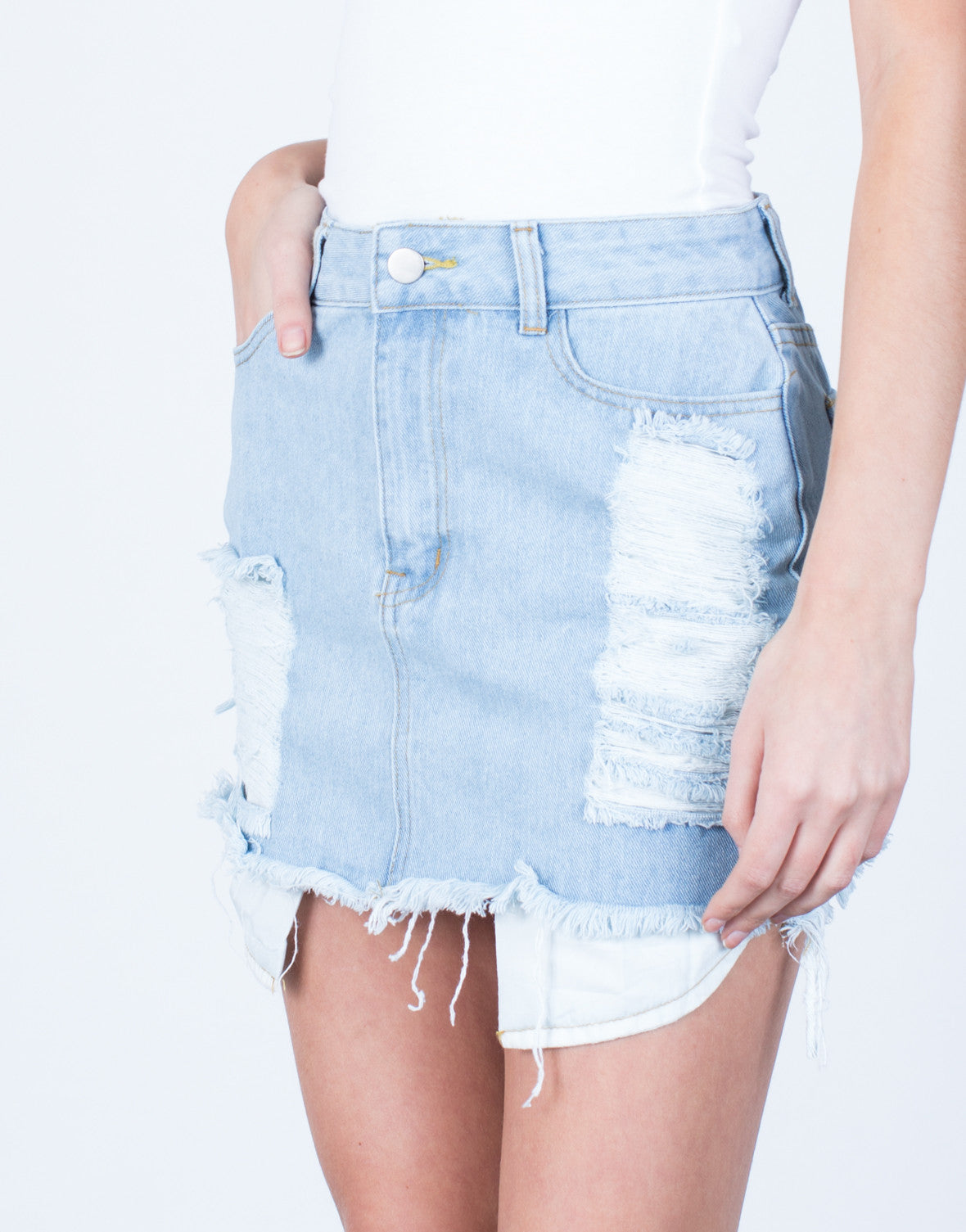 Detail of Shredded Mini Denim Skirt