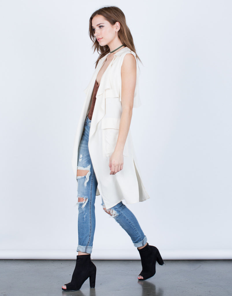 Side View of Sleeveless Belted Jacket