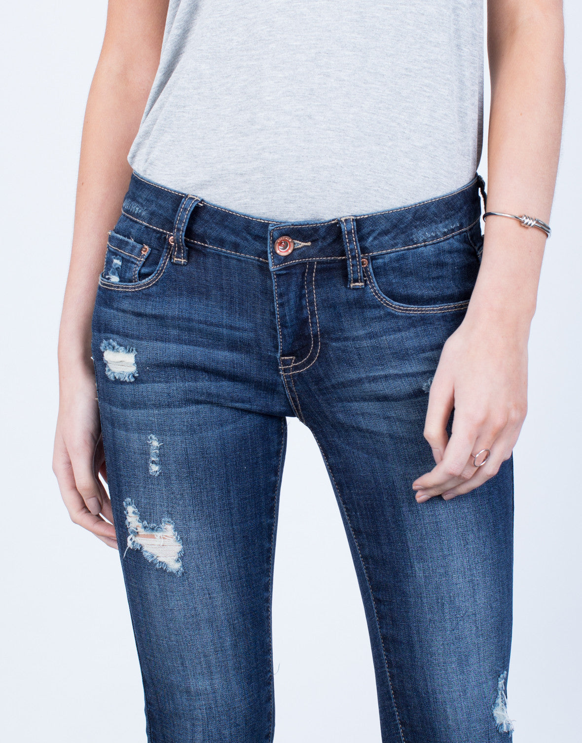 Detail of Slightly Distressed Capri Denim Jeans