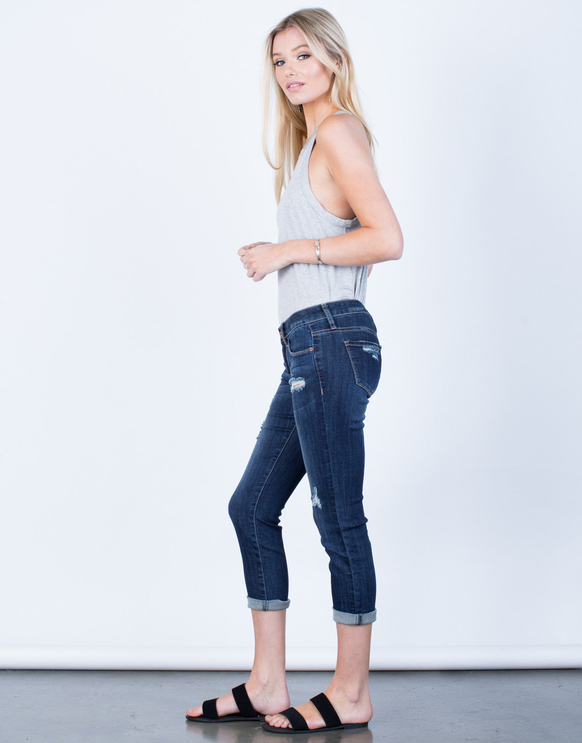 Side View of Slightly Distressed Capri Denim Jeans