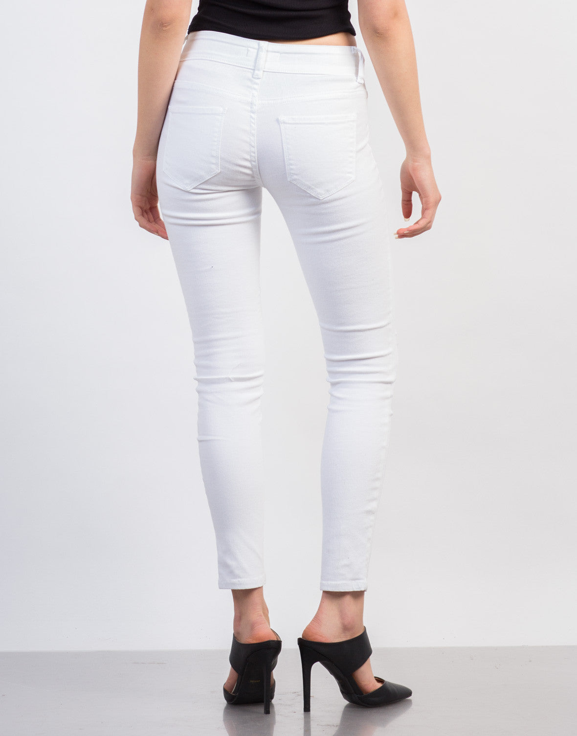 Back View of Slightly Distressed White Skinny Jeans