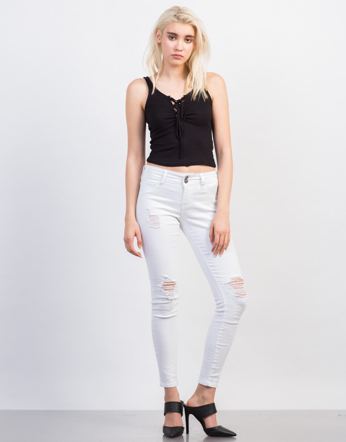 Front View of Slightly Distressed White Skinny Jeans