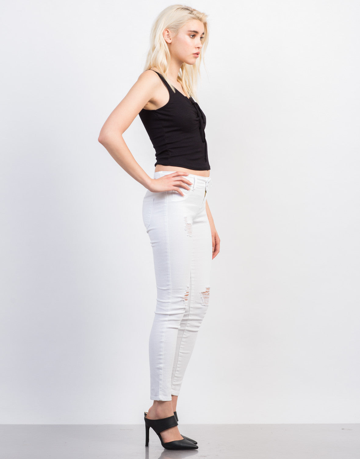 Side View of Slightly Distressed White Skinny Jeans