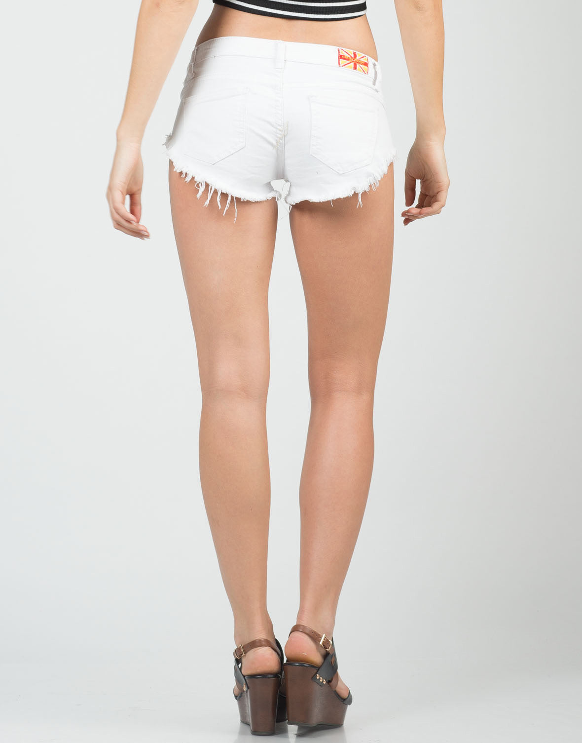 Back View of Summer White Frayed Denim Shorts