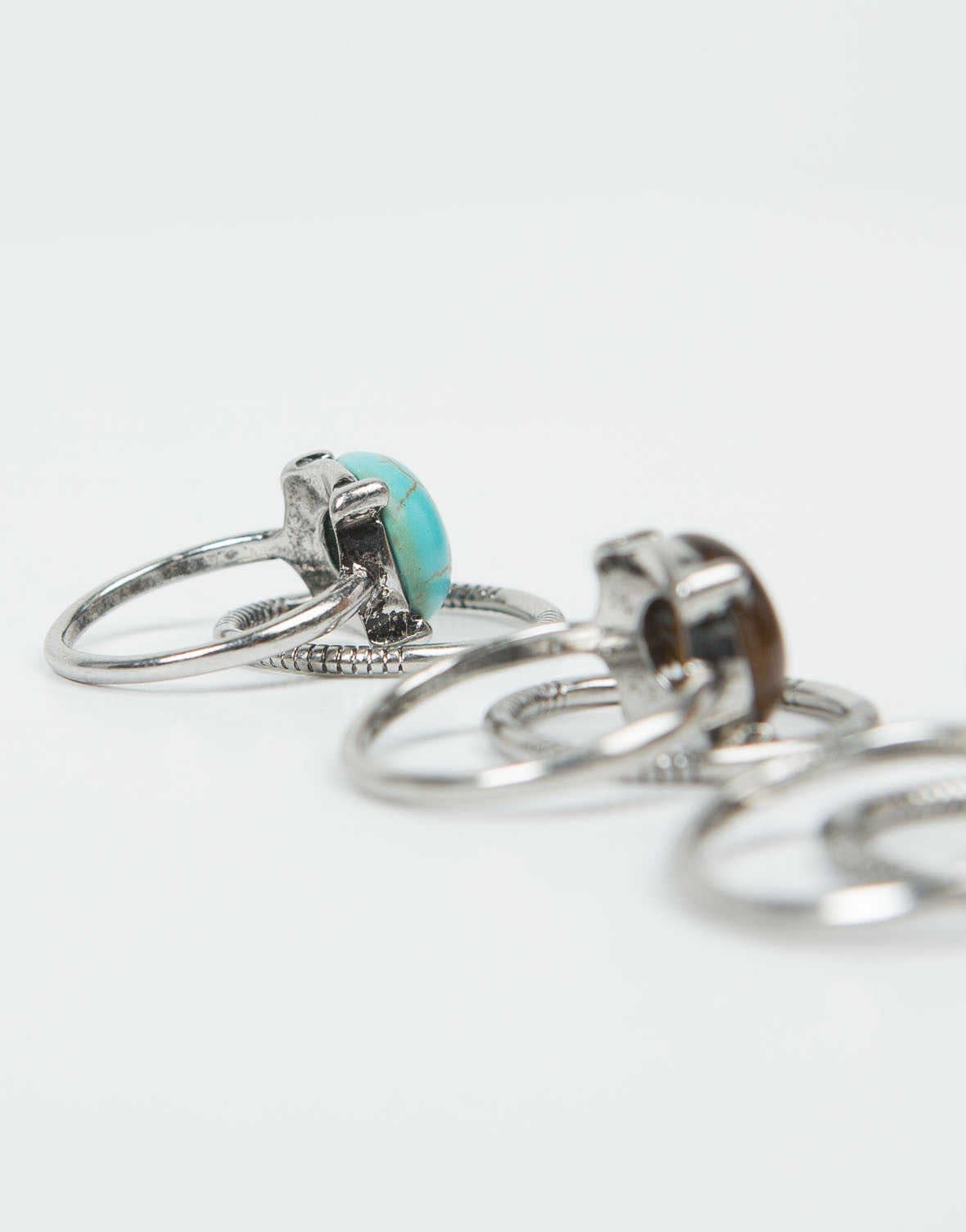 Side View of Triple Stone Banded Ring Set