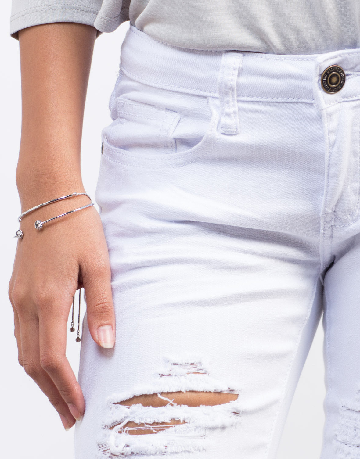 Detail of White Destroyed Skinny Jeans