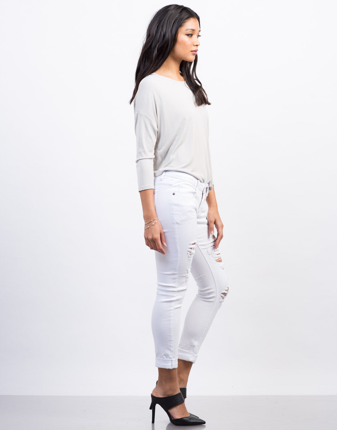 Side View of White Destroyed Skinny Jeans