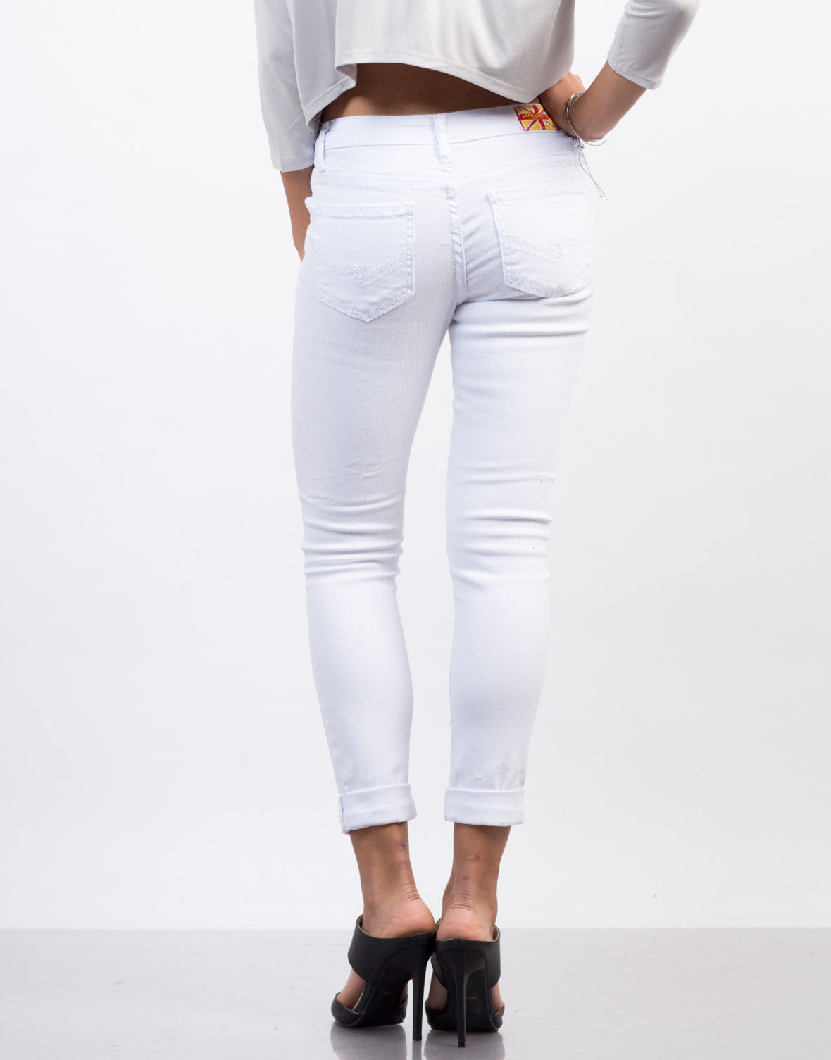 Back View of White Mid-Rise Destroyed Jeans
