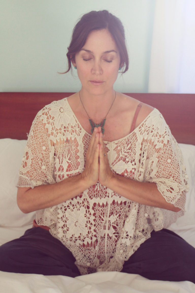 Carrie-Anne Moss meditating