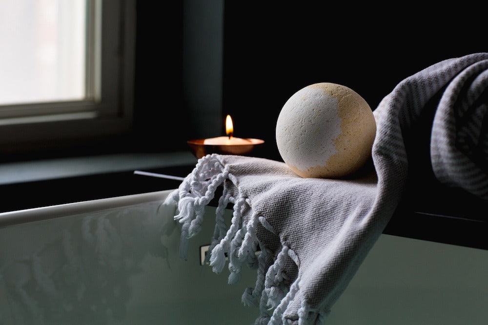 bathtub with candle LOTUSWEI flower essences