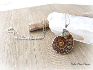 Ammonite shell stone silver frame pendant with silver chain necklace.