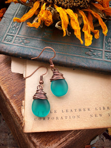 Frosted teal teardrop Czech glass and copper wire wrapped earrings.