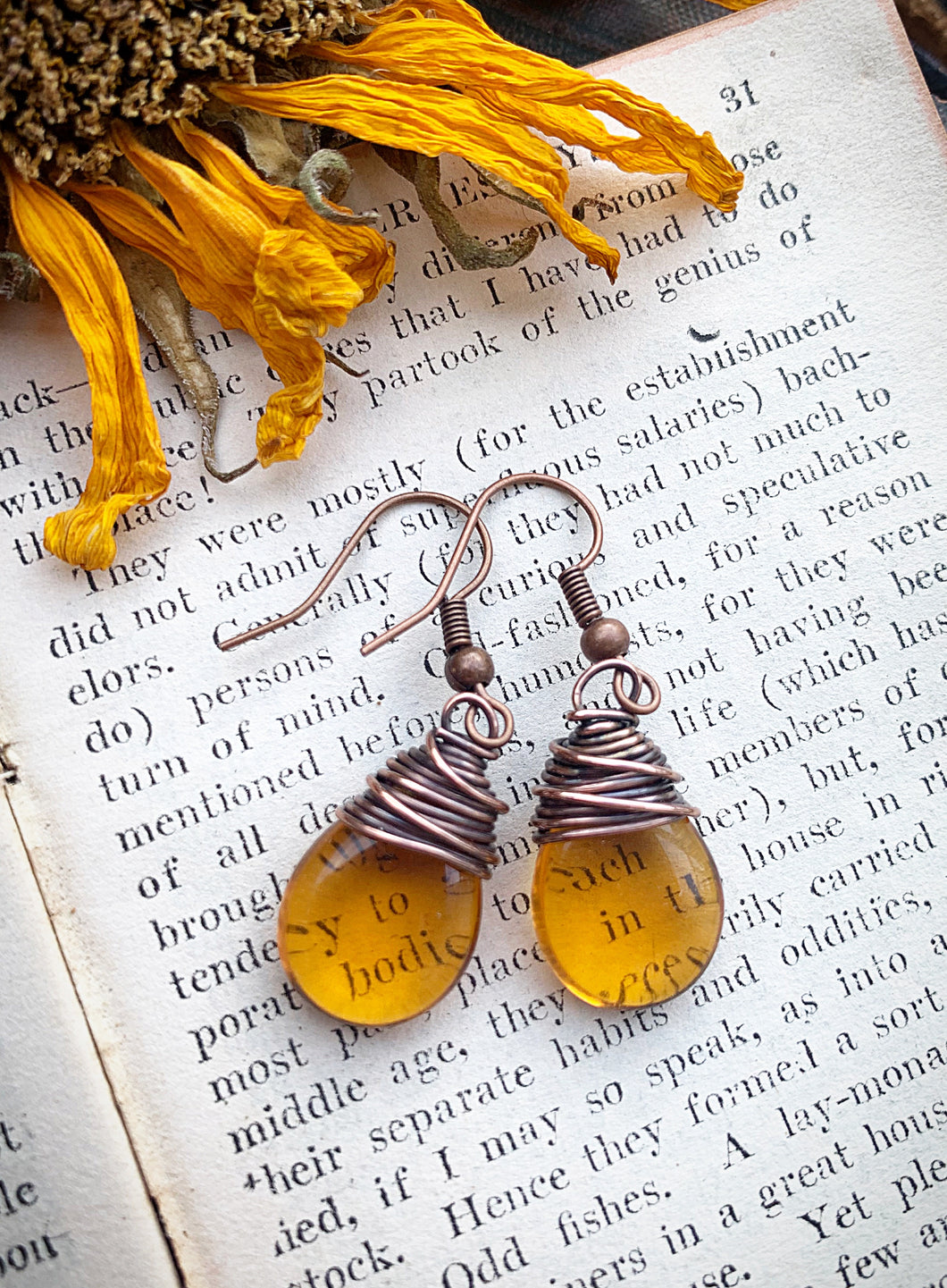 Amber teardrop Czech glass and copper wire wrapped earrings.