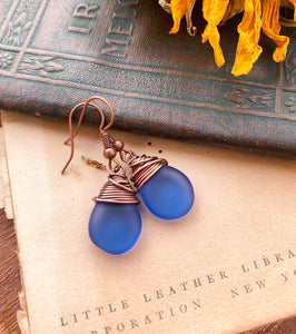 Blue frosted teardrop Czech glass and copper wire wrapped earrings.