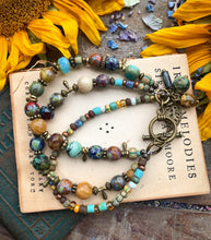 Load image into Gallery viewer, Namaste. Czech glass, multi strand, bronze metal bracelet. - Andria Bieber Designs