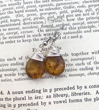 Load image into Gallery viewer, Cougar print transparent teardrop Czech glass and silver wire wrapped, sterling silver earrings.