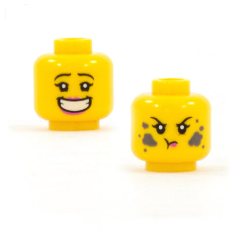 Female LEGO head with a huge open smile on one side, and a dirty, grumpy face on the other side.
