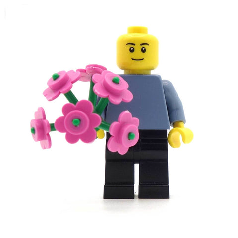 LEGO Minifigure Holding Bunch of pink flowers