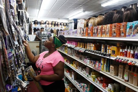 Photo Credit: Kirsten Luce https://www.nytimes.com/2014/09/09/nyregion/black-women-find-a-growing-business-opportunity-care-for-their-hair.html