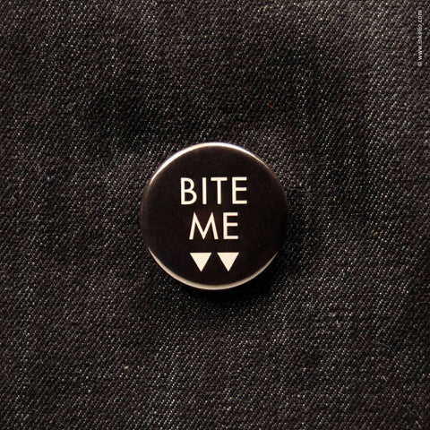 Front of Inkello Halloween Bite Me Fangs 1 1/4 inch Button With Pin - 603