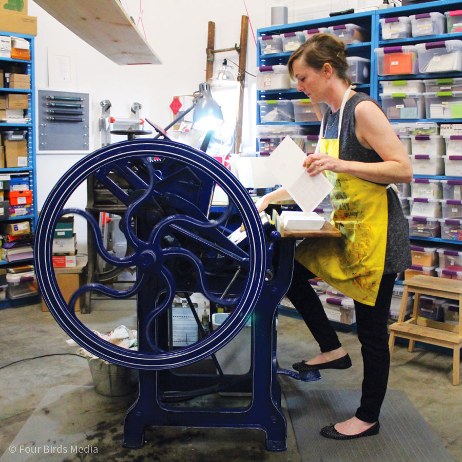 Christy printing greeting cards in Inkello studio