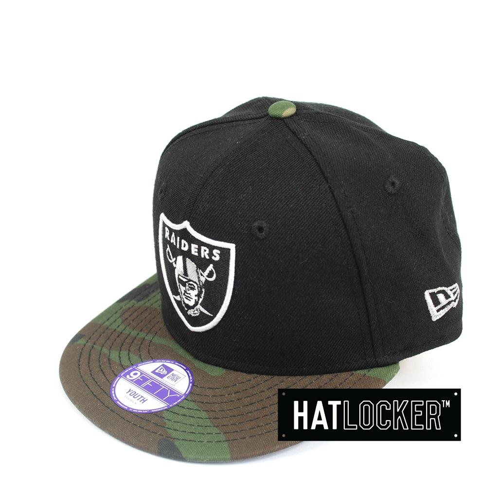 668acdfda88 New Era Oakland Raiders Youth Black Camo Snapback Hat