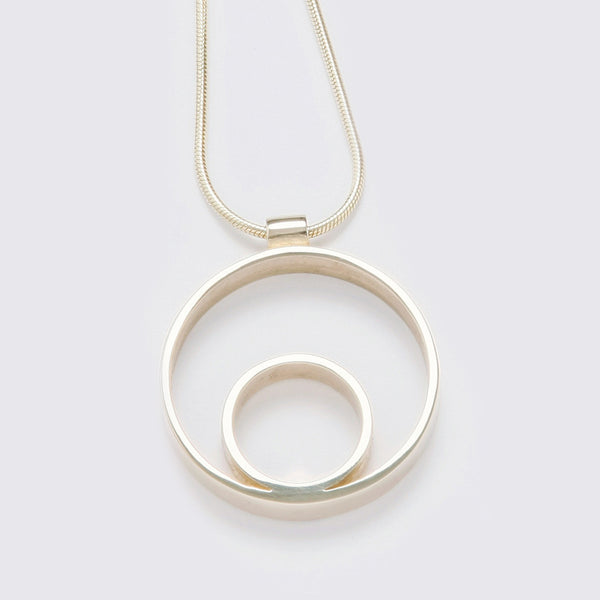 Circles Medium Gold Pendant. Material: 9ct yellow gold. Measurements: 31mm outside diameter. Design Year: 2006