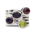 These gorgeous rings can be worn on their own, or stacked. They come in a wonderful variety of colours. Garnet (red wine colour), Iolite (navy blue ink colour), Amethyst (purple) and Peridote (green). Unique designer jewellery handcrafted in Ireland.