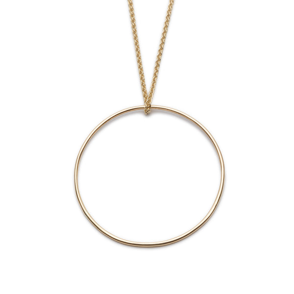 "Large Circle Pendant. Material: 9ct Yellow Gold. Measurements: Pendant is 32mm outside diameter, spiga chain is 18"". Design Year: 2014"