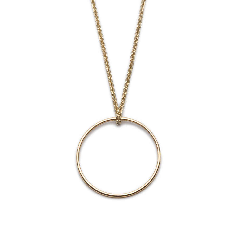 "Gold Circle. Small Round Pendant. Material: 9ct Yellow Gold. Measurements: Circle is 22mm outside diameter, on 18"" spiga chain. Design Year: 2014"