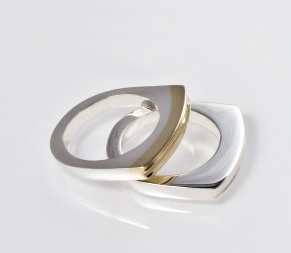 Atlantic Rings Material: Sterling silver, Sterling silver & 9ct yellow gold Measurements: 23mm across  Design Year: 2001
