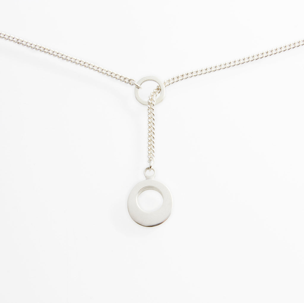 "Silver Lariat Pendant. Material : Sterling Silver. Measurements: Pendant 11mm diameter (approx.) Chain 45cm/18"" with adjuster at 42cm/16"". Design Year: 2013"