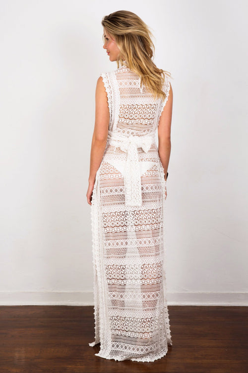 Sheer lace maxi dress with sophisticated high neckline and featuring eye-catching embroidery allover and dramatic side slits