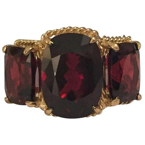 Elegant Three Stone Garnet Ring with Gold Rope Twist Border