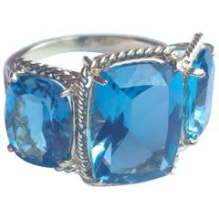 Blue Topaz Three Stone Ring with Twisted Rope Twist Border