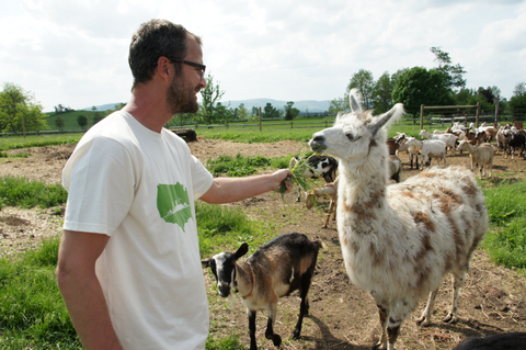 Josh with a llama and goat.