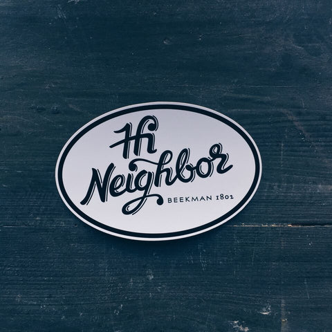 "A sticker that says ""Hi Neighbor""."
