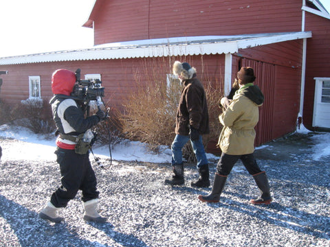 Cameraman filming Josh and Brent on the farm.