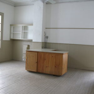 Empty room with countertop and cabinets.