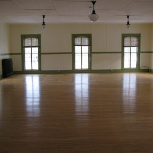 Empty room with three large windows.