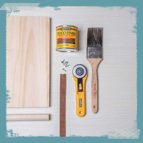 Wood, dowels, a can of wood stain, a paint brush, a rotary cutter.
